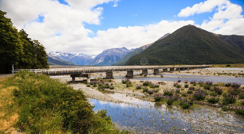 Beautiful Panoramic scenic view of Arthur`s pass bridge with Arthur`s Pass National Park Panoramic scenery in summertime royalty free stock image