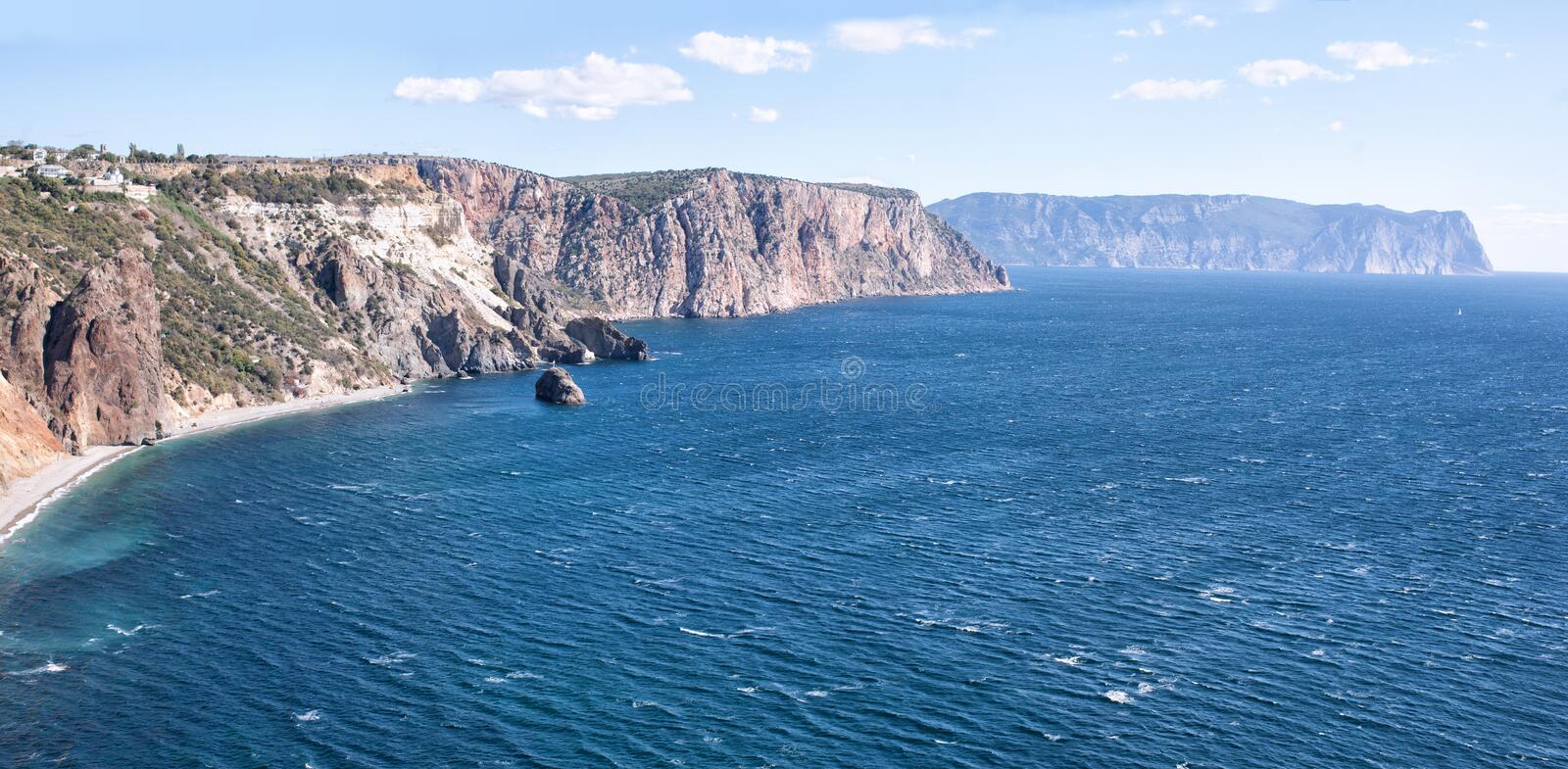 Beautiful panoramic seascape of Black sea. Beautiful seashore. Panoramic seascape of Black sea in region of Fiolent cape. Panorama photomerge of several photos royalty free stock images