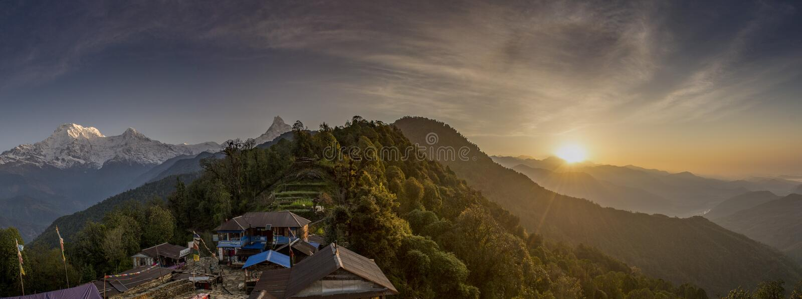 Beautiful panoramic sunset landscape with guest house located in the Himalaya mountains stock photos