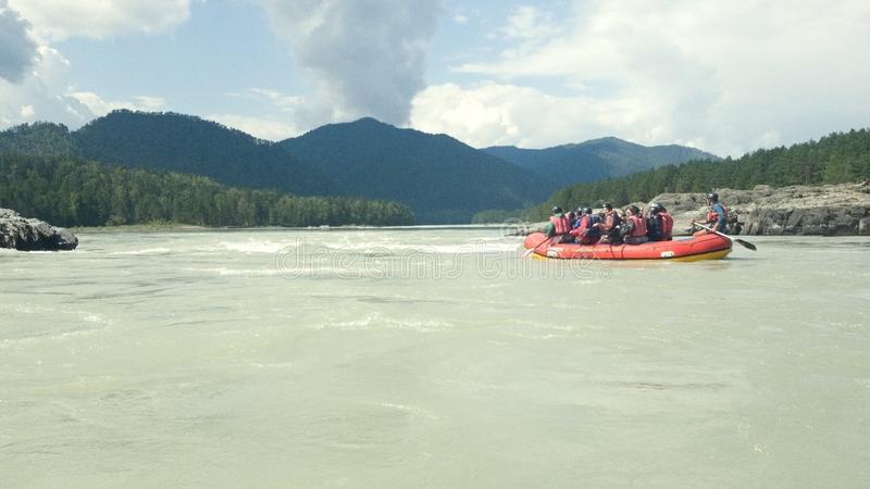 Beautiful panoramic view of the beautiful calm Katun river with small rapids. Bright white water rafting in the Altai region stock image