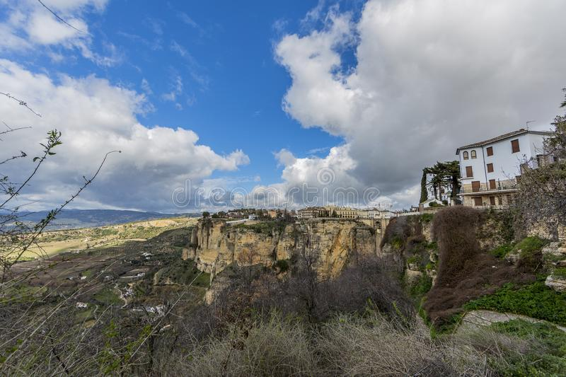 Beautiful panoramic view of the city of Ronda over the mountain with its valley with farmland royalty free stock photos