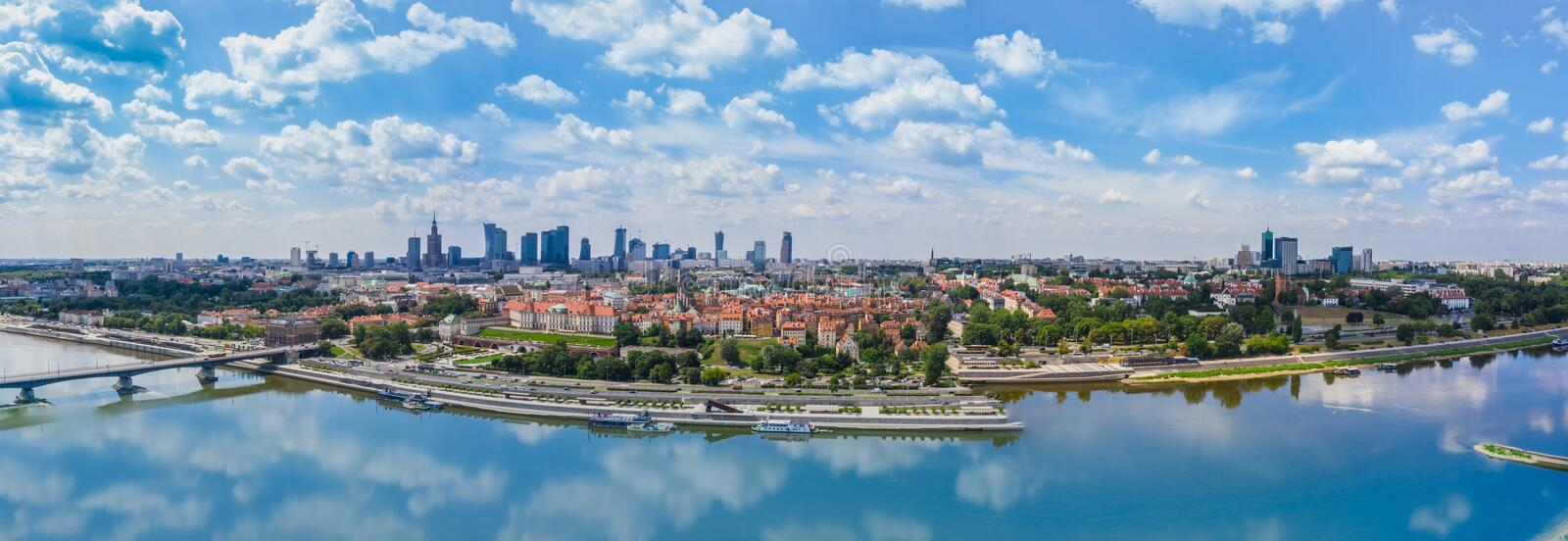 Beautiful panoramic view over the roofs of the Old Town to the Center of Warsaw, the Palace of culture and science, modern royalty free stock photography