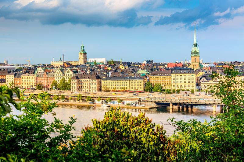Beautiful panoramic view of Stockholm Old town Gamla Stan with church of St. Nicholas. Summer sunny day in Stockholm, Sweden stock images