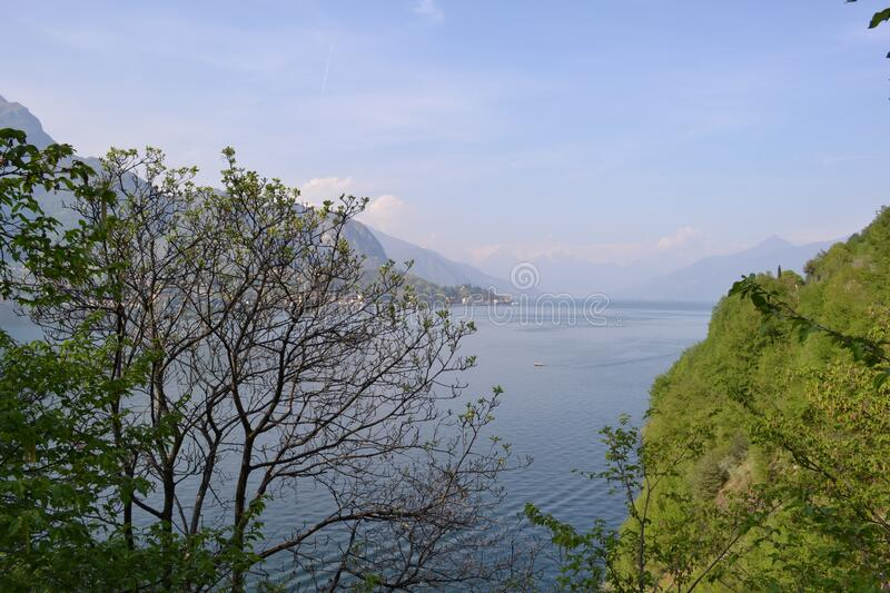 Beautiful panoramic view to the lake Como, lakefront, motorboat moving. stock photos