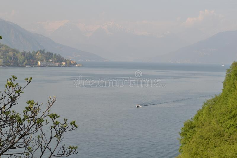 Beautiful panoramic view to the lake Como, lakefront, motorboat moving. stock images