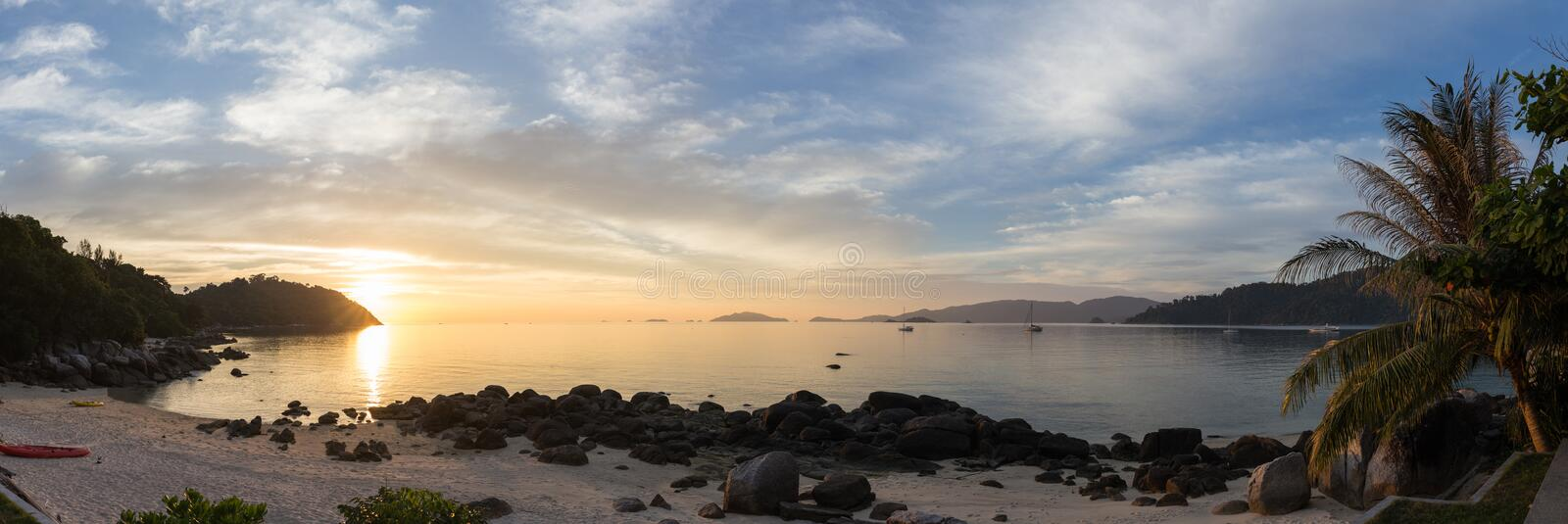 Beautiful panoramic view of tropical beach with sunset royalty free stock photos