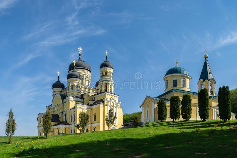 Beautiful panoramic view of two stone churches in Hincu Monastery, Moldova. Beautiful panoramic view of two stone orthodox churches in Hincu Monastery, Moldova stock photography