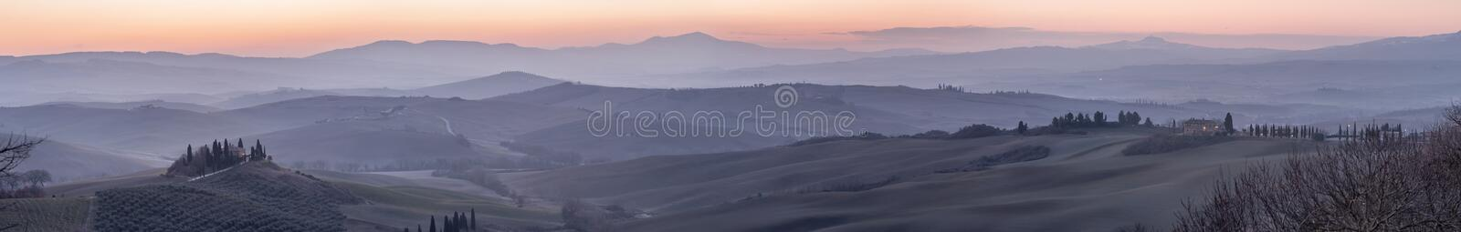 Beautiful panoramic view of the Val d`Orcia hills at the dawn of a new day, Siena, Tuscany, Italy royalty free stock photo