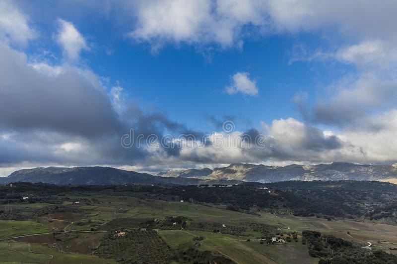 Beautiful panoramic view of the Valley or Vega de Ronda with its farmland and mountains in the background stock photography