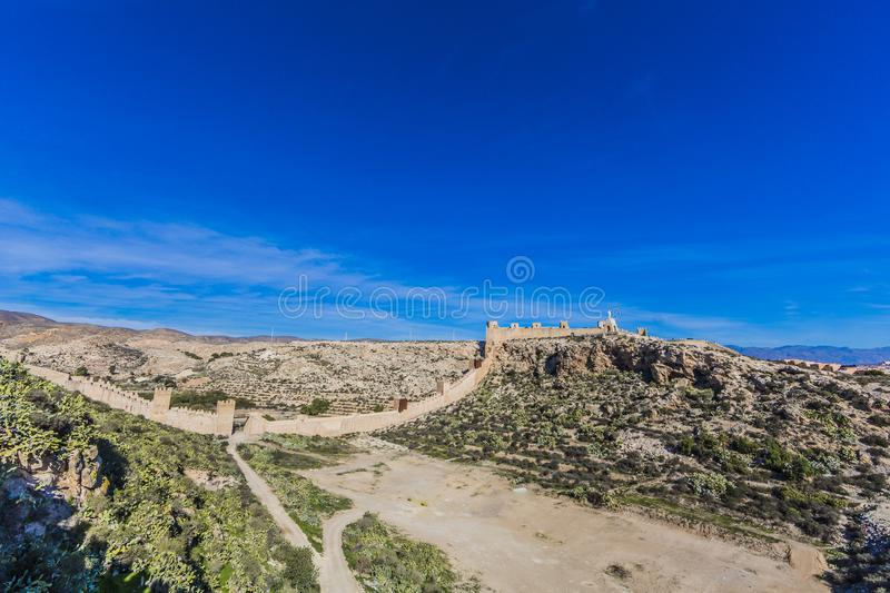 Beautiful panoramic view of the walls of the Alcazaba de Almeria in Spain on a rocky terrain royalty free stock photo