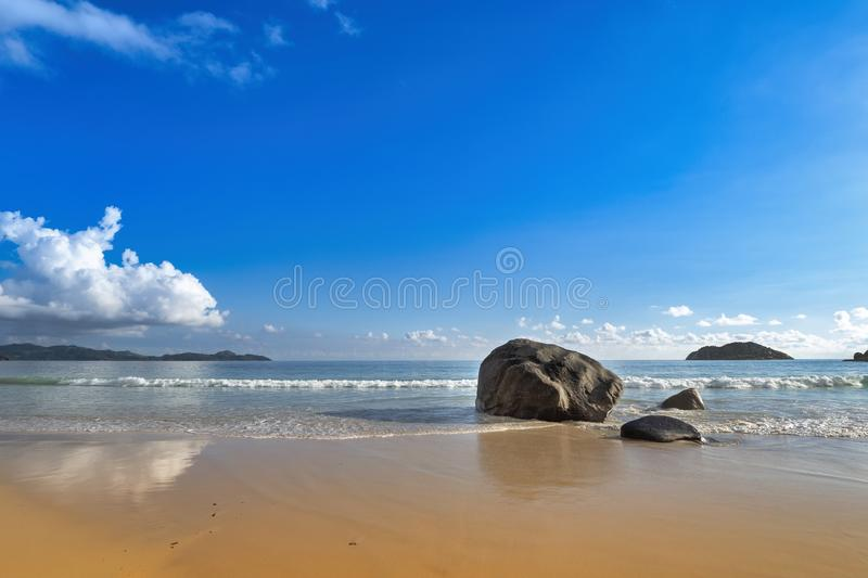 Wide island beach with rock and blue sky royalty free stock photos