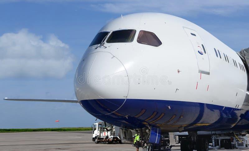 Beautiful passengers plane at airport. Blue sky. stock photos