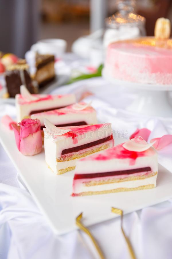 Beautiful pastry. cakes and macaroons. Sweet holiday buffet with cupcakes, cakes and other sweet desserts. Some sweet delicious snacks for the party stock photos