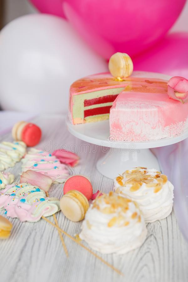 Beautiful pastry. cakes and macaroons. Sweet holiday buffet with cupcakes, cakes and other sweet desserts. Some sweet delicious snacks for the party stock image