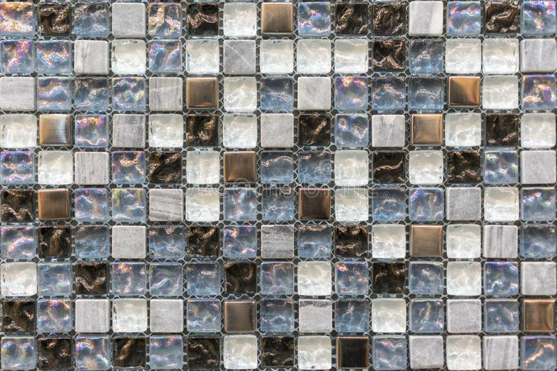 The beautiful pattern of ceramics wall texture for background. Ceramic glass colorful tiles mosaic composition pattern background.  stock images