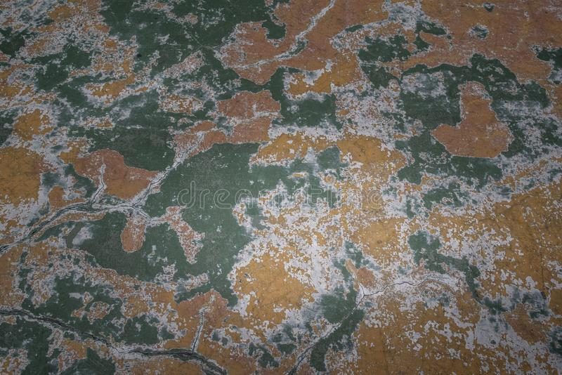 Beautiful patterns on the Old plastered field with falling off flakes of paint. Texture, background, different color patterns royalty free stock photography