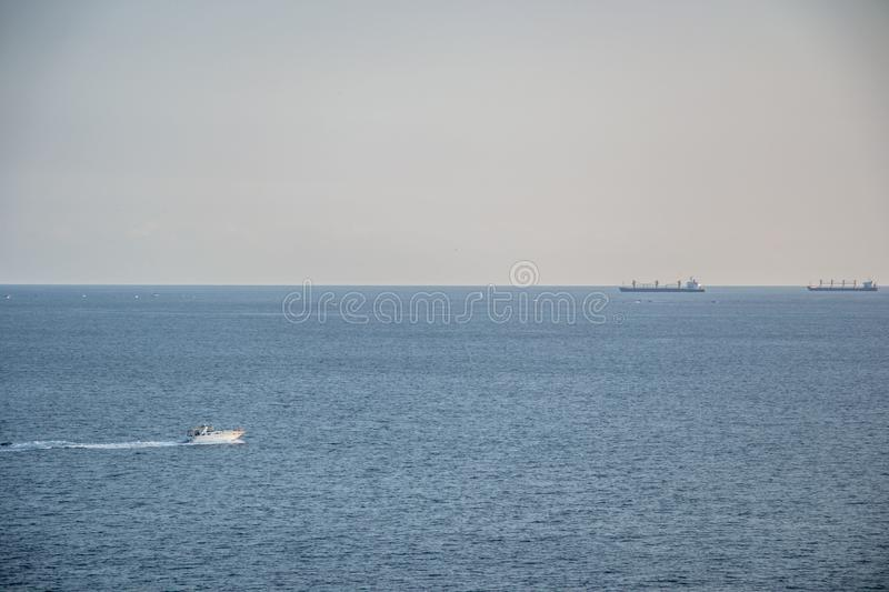 Beautiful peaceful waters, Black sea, blue sky and calm water, ships and yachts in the sea. The waters in Black Sea, calm and peaceful water, ship and yachts royalty free stock image