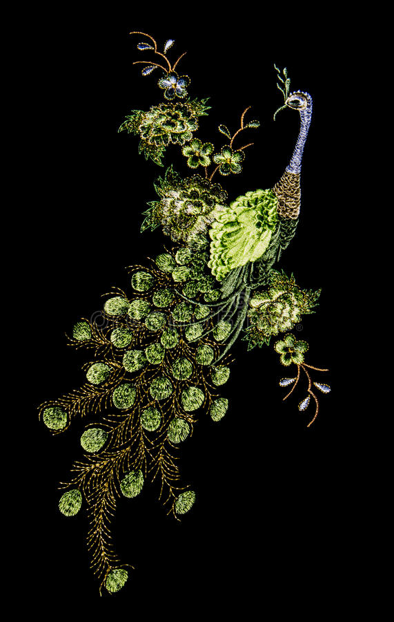 Beautiful peacock embroider. On black background stock images