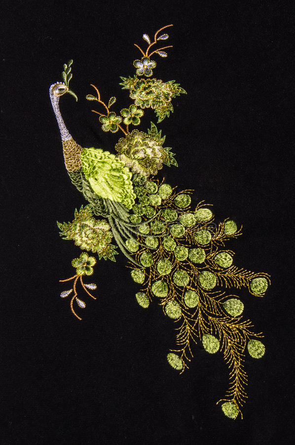 Beautiful peacock embroider. On black background stock photo