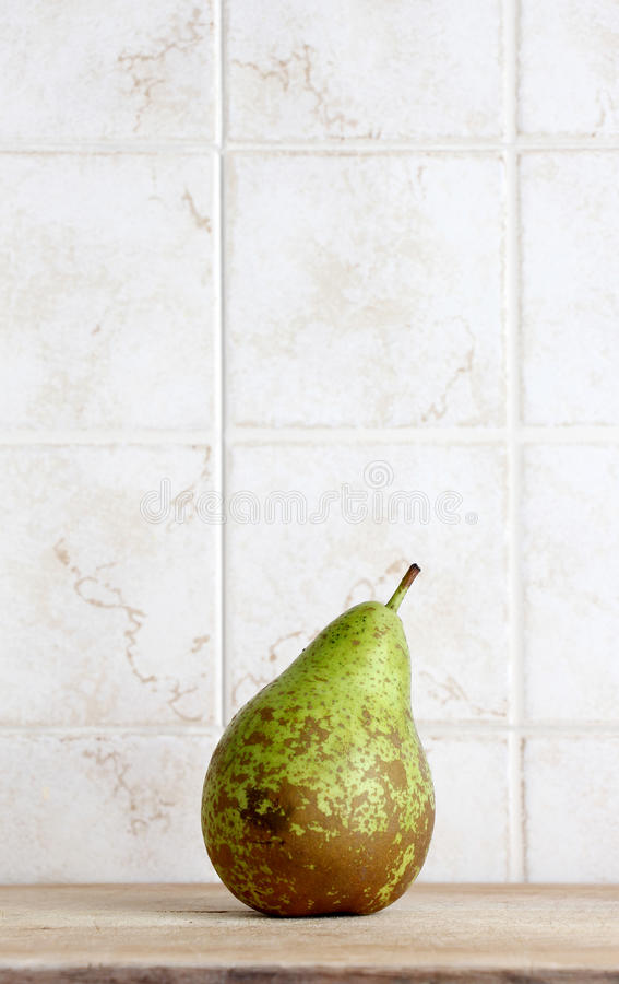 A beautiful pear on a chopping board, space for text stock image