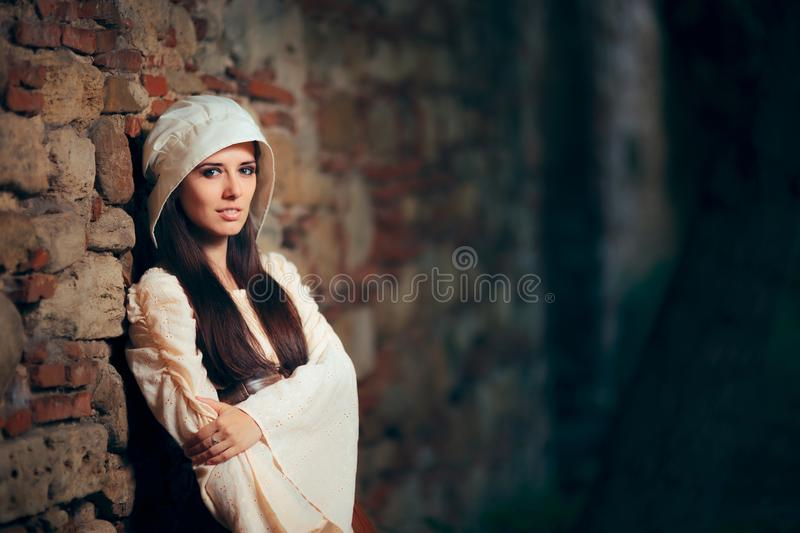 Medieval Woman in Historical Costume Wearing Corset Dress and Bonnet royalty free stock photography