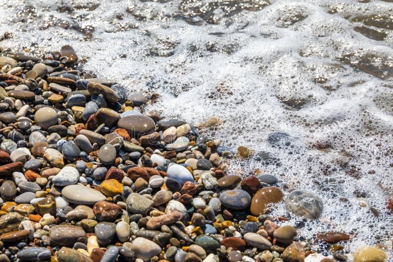 Beautiful pebbles on the beach close up stock photo