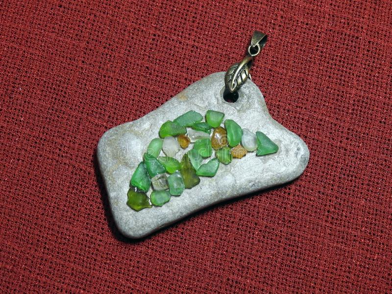 Handmade pendant using sea glass and sea stone, Lithuania stock images