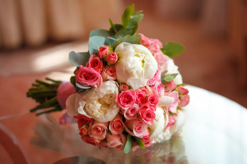 Beautiful peony and rose wedding bouquet. Marriage concept. Beautiful peony and rose wedding bouquet, closeup. Marriage concept royalty free stock photography