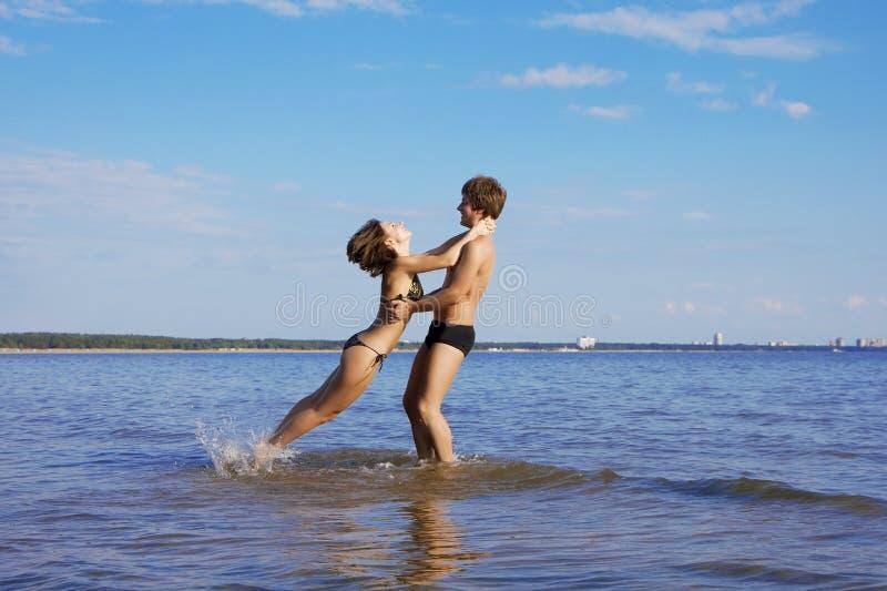 Beautiful people in love on the beach stock photo