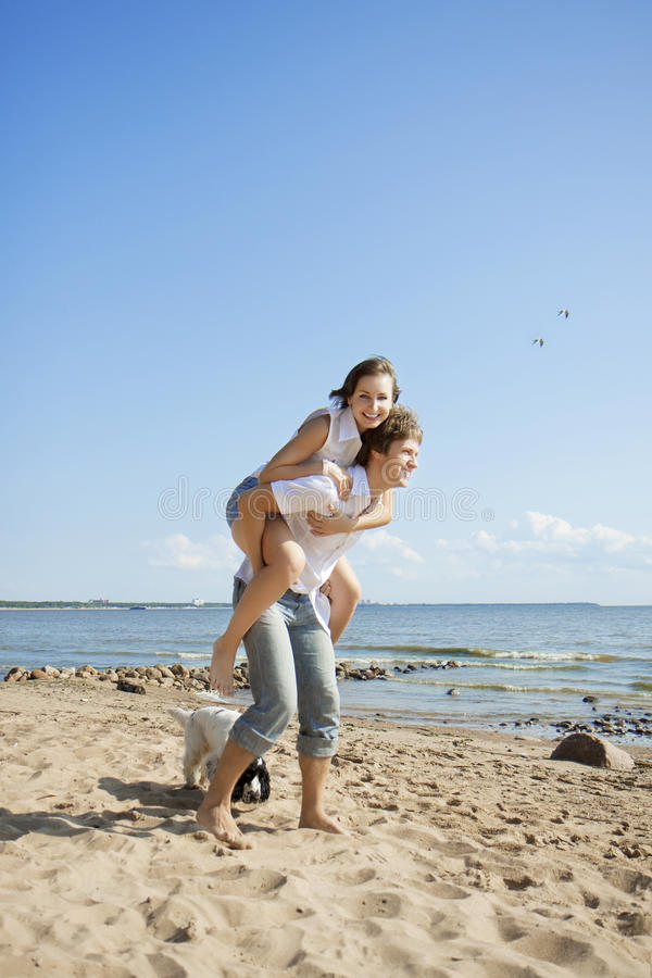 Beautiful people in love on the beach royalty free stock photos
