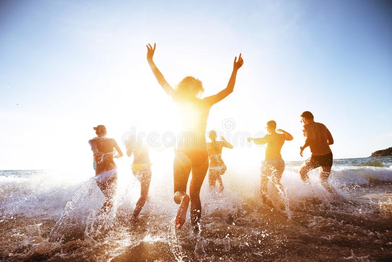 Beautiful people sunset sea beach royalty free stock photography