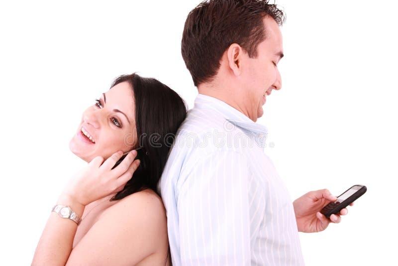 Beautiful people talk on a mobile telephone