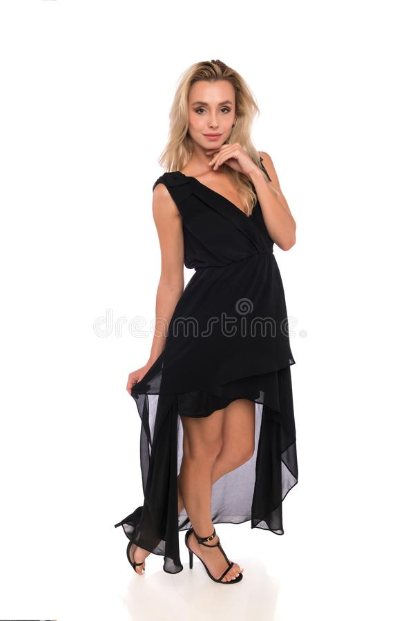 2bced49803b Blonde in a black dress stock image. Image of petite - 102089073
