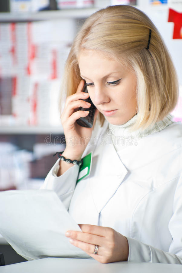 Download Beautiful pharmacist. stock image. Image of listening - 18492209