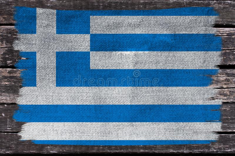 Beautiful photo of the colored national flag of the modern state of Greece on textured fabric, concept of tourism, emigration, royalty free stock photos