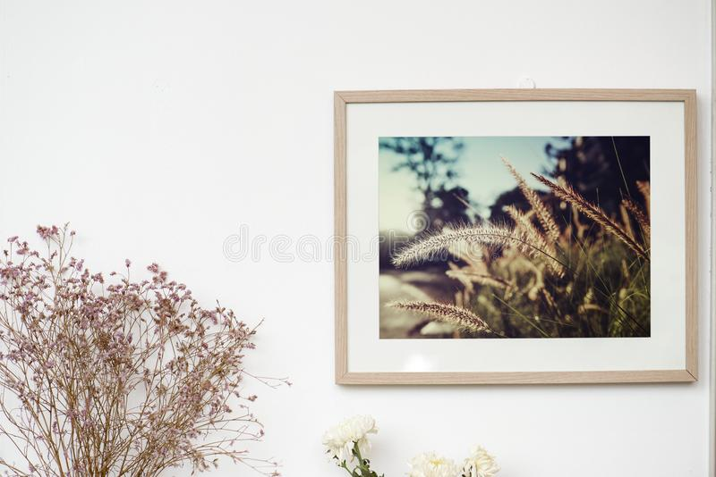Beautiful photo in a frame hanging on a wall stock photo