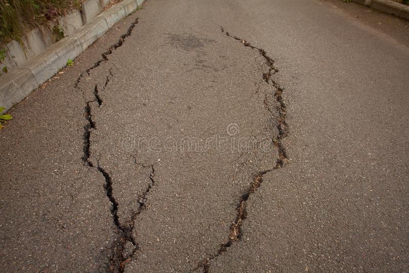 Photo of gray cracked asphalt pavement royalty free stock photography