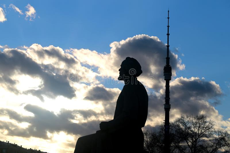 Beautiful photo of a statue of Tsiolkovsky scientist. And the Ostankino tower against the sky royalty free stock photography