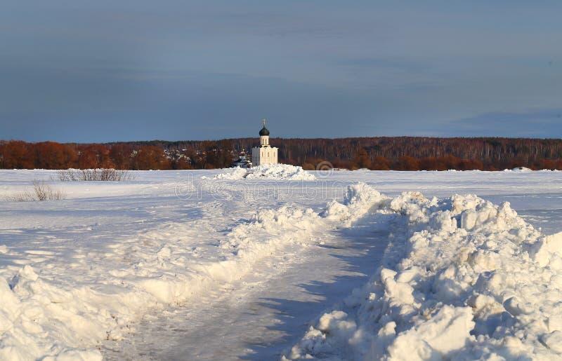 Photo of the winter landscape of the white Christian Church Bogolyubovo stock photo