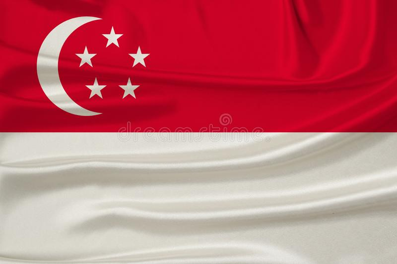 Beautiful photograph of the national flag of Singapore on delicate shiny silk with soft draperies, the concept of state power,. Country life, horizontal, close royalty free stock photo