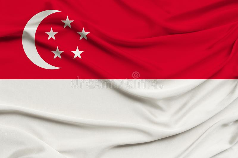 Beautiful photograph of the national flag of Singapore on delicate shiny silk with soft draperies, the concept of state power,. Country life, horizontal, close stock photo