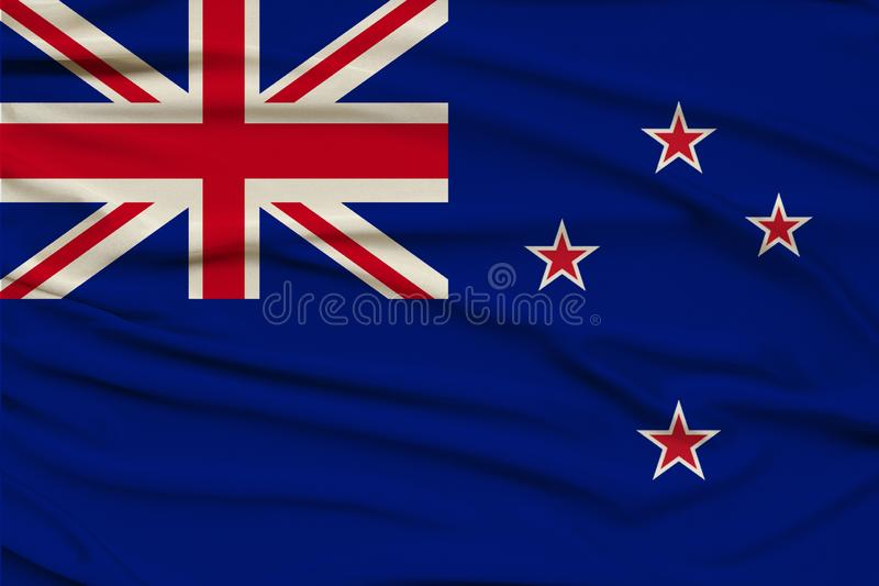 Beautiful photograph of the New Zealand national flag on delicate shiny silk with soft draperies, the concept of state power,. Country life, horizontal, close stock photo