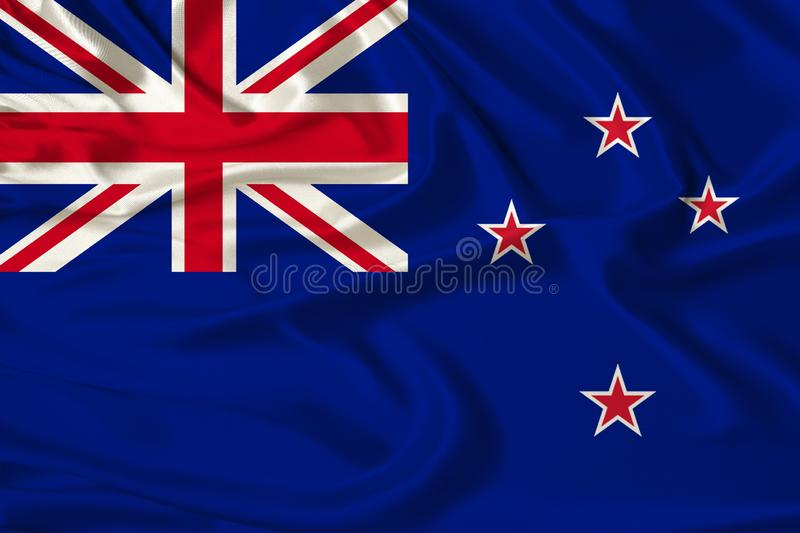Beautiful photograph of the New Zealand national flag on delicate shiny silk with soft draperies, the concept of state power,. Country life, horizontal, close royalty free stock photo