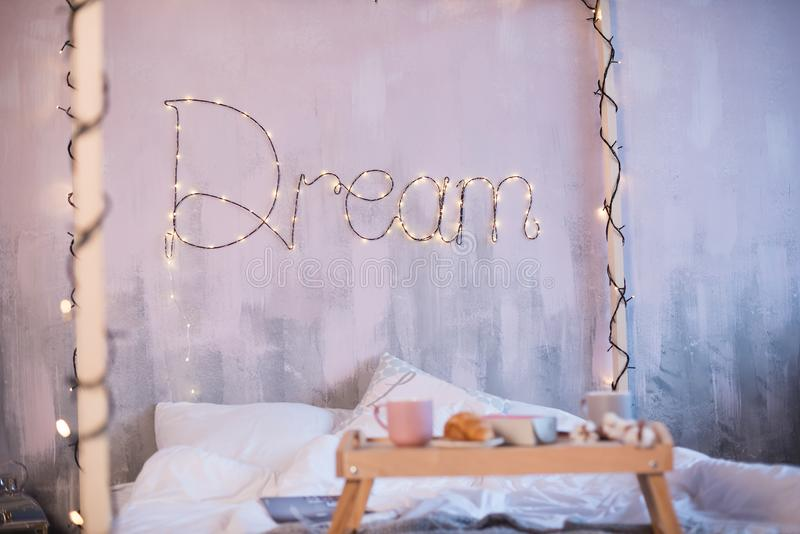 Beautiful photozone with a big bed and the word Dream stock photo