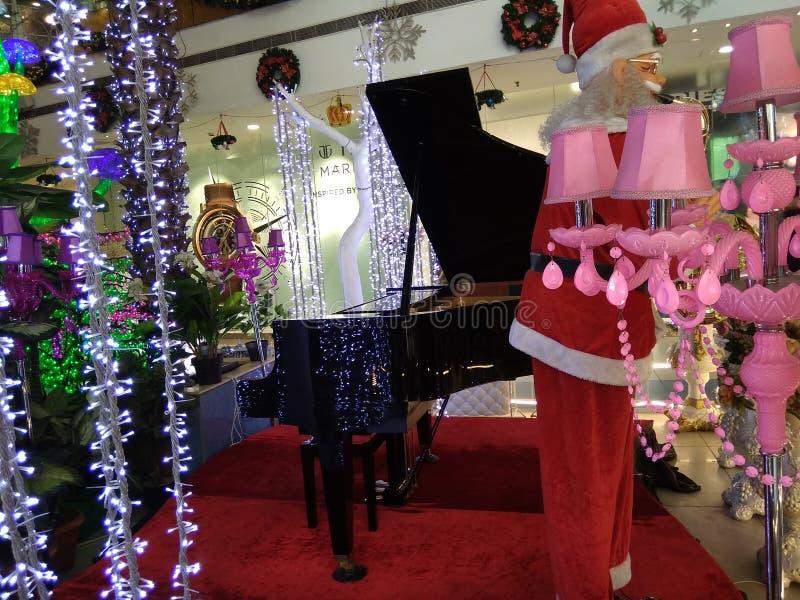So beautiful black and white piano and Santa Claus royalty free stock photo