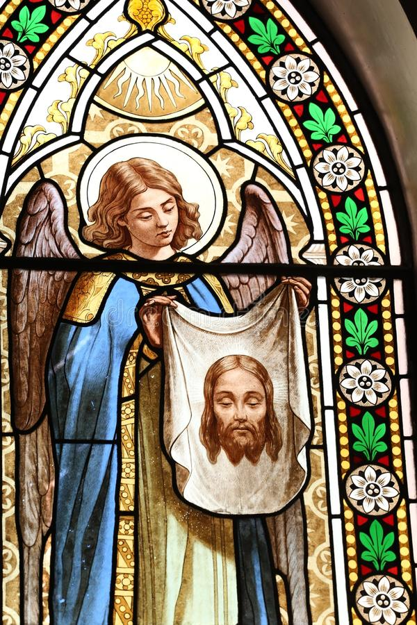 A beautiful stained glass in St.Alfonso de Liguori`s church, Rome. A beautiful picture of an angel in stained glass in St.Alfonso de Liguori`s church, Rome stock images