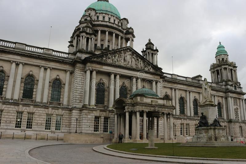 Beautiful picture of city hall in Belfast Northern Ireland, with a gloomy sky and dark clouds royalty free stock image