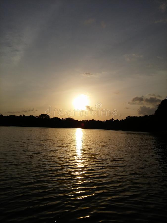Beautiful picture of evening sun set. Very beautiful of evening sun set in sri lanka athugala lake stock photos