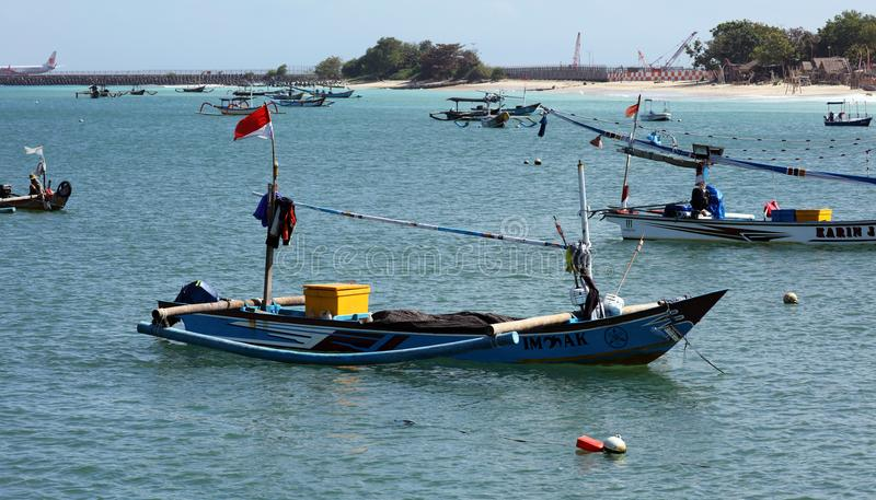 Beautiful picture of fishing boats at Jimbaran Bay at Bali Indonesia, beach, ocean, fishing boats and airport in photo. royalty free stock photos