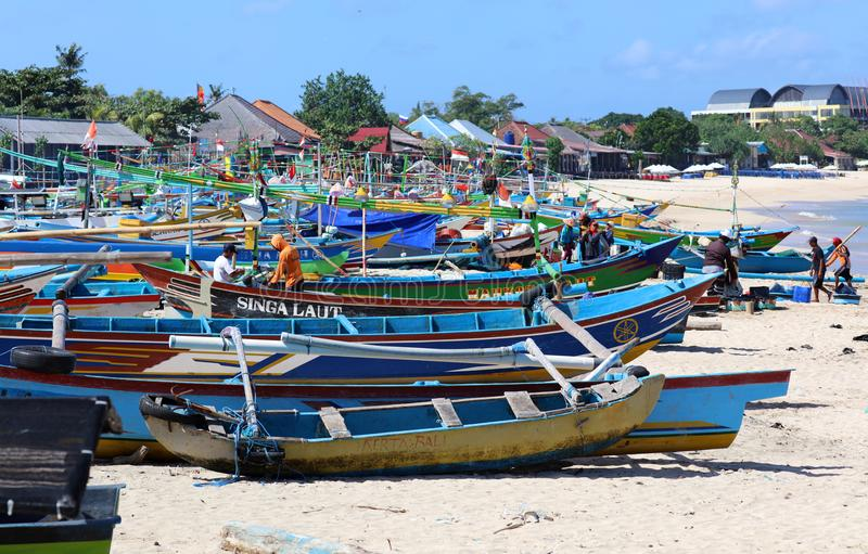 Beautiful picture of fishing boats at Jimbaran Bay at Bali Indonesia, beach, ocean, fishing boats and airport in photo. Wide panoramic picture of Jimbaran Bay royalty free stock photos